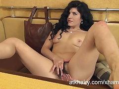 Markiza masturbates her floccose pussy in a table kiosk