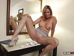 MILF in pantyhose plays around for you