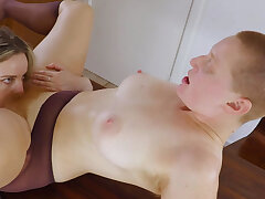 Hairy lesbian redhead gets her bush licked on the table