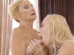 Blonde girl eating granny's old pussy