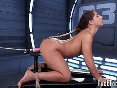 Unostentatious babe pussy toyed apart from dildo machine