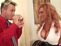 Busty redhead Sharon Pink is a get-up-and-go secretary that loves titty shafting
